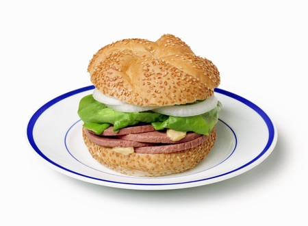 sesame seed bun: Liverwurst and Onion Sandwich on Sesame Seed Bun; On Plate; White Background