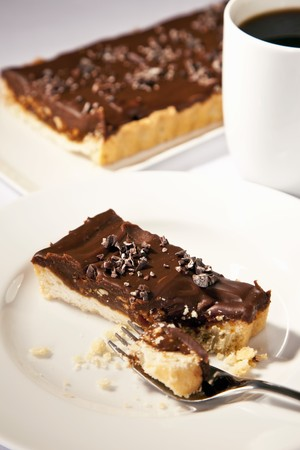 shortbread: Piece of Chocolate Hazelnut Tart with Shortbread Crust; Fork; Espresso LANG_EVOIMAGES