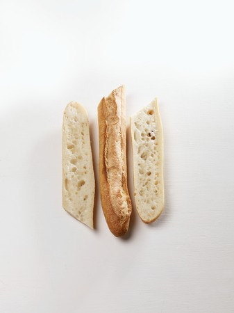 several breads: A sliced baguette