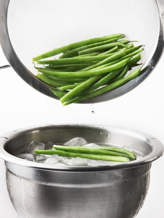blanch: Blanched beans being quenched in iced water