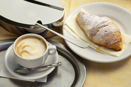 crema: Caffe crema, a croissant and a sugar tin