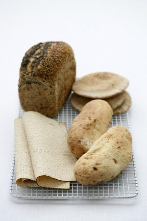 several breads: Wholemeal bread, flat bread and bread rolls