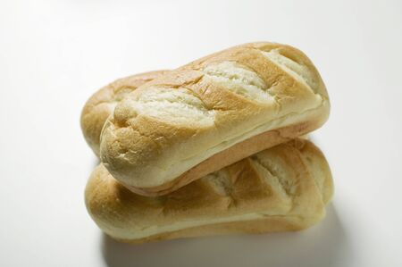 several breads: Three bloomers (crusty white loaves) LANG_EVOIMAGES