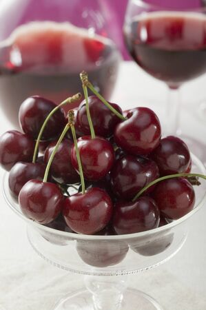 in twos: Cherries in a stemmed glass bowl LANG_EVOIMAGES