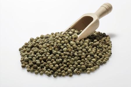 wooden scoop: Green peppercorns with wooden scoop