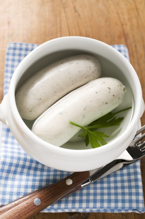 weisswurst: Two cooked Weisswurst in soup cup