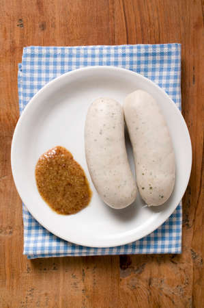 weisswurst: Two cooked Weisswurst with mustard on plate