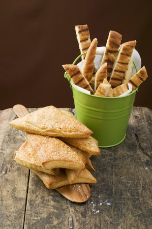 several breads: Triangular puff pastry pasties and grilled pizza bread LANG_EVOIMAGES