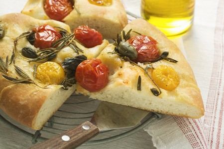 substantial: Three pieces of pizza with cherry tomatoes, capers & rosemary