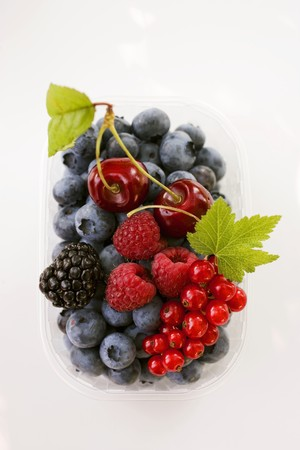 cherry varieties: Assorted berries and two cherries in plastic punnet LANG_EVOIMAGES