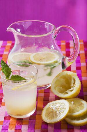 soda pops: Lemonade in glass and jug