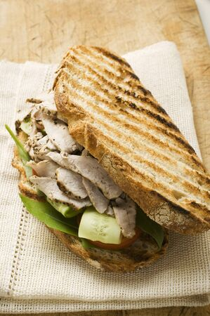 qs: Grilled bread with turkey, cucumber and tomato