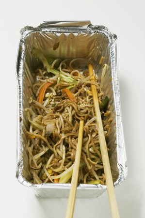 mian: Remains of fried noodles in aluminium container