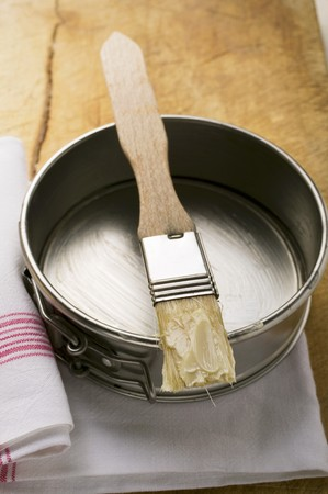 grease paint: Pastry brush with butter on baking tin