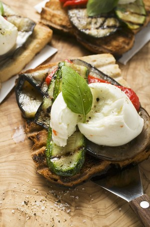 substantial: Toast with grilled vegetables, mozzarella and basil LANG_EVOIMAGES