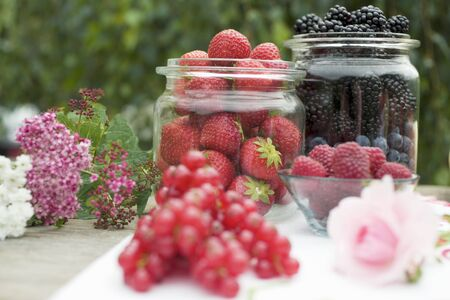 Fresh berries on table out of doors