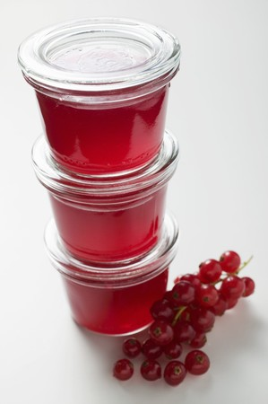 redcurrant: Three jars of redcurrant jelly with fresh redcurrants