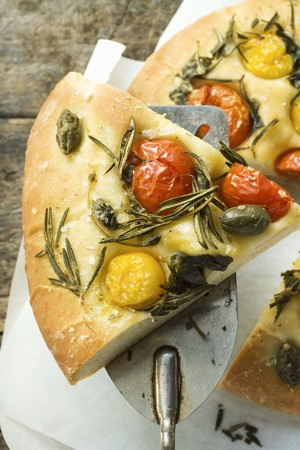 substantial: Pizza with cherry tomatoes, capers & rosemary (slice on server)