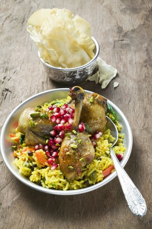 substantial: Chicken legs with saffron rice & pomegranate seeds (Asia)