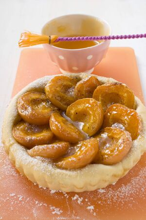 marillenmarmelade: Apricot tart, apricot jam with pastry brush behind it