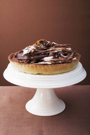 chocolate tart: Whole chocolate tart on cake stand