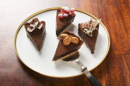 chocolate tart: Four pieces of chocolate tart with different decorations