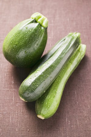 cocozelle: Round and long courgettes with drops of water