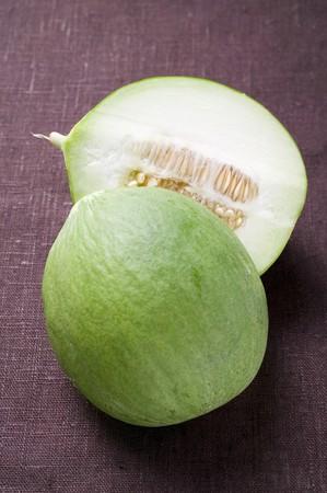 halved: Green honeydew melon, halved