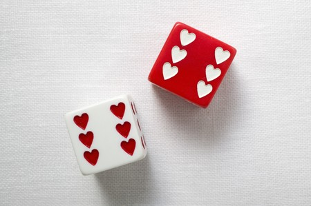 in twos: Two dice with hearts for Valentines Day