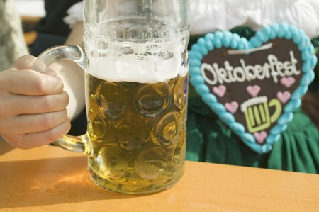 litre: Woman with litre of beer at Oktoberfest LANG_EVOIMAGES