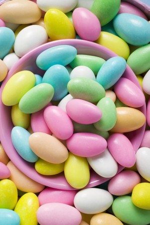 sugared almonds: Sugared almonds, in and around pink bowl