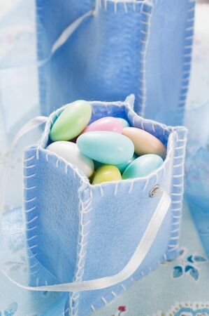 sugared almonds: Sugared almonds in blue felt bag