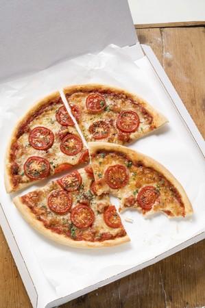 quartered: Cheese & tomato pizza with oregano (quartered) in pizza box