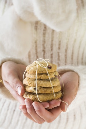 christmassy: Hands holding cranberry cookies (Christmassy) LANG_EVOIMAGES