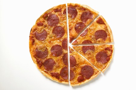 half cut: Pepperoni pizza, one half cut into slices LANG_EVOIMAGES
