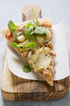 tunafish: Slice of tuna and onion pizza with fresh oregano