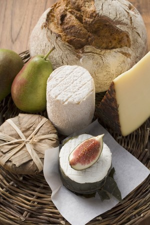 several breads: Cheese still life with bread, pears and fig