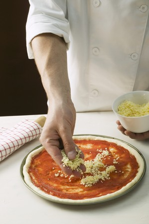 bases: Sprinkling pizza with cheese