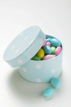 sugared almonds: Coloured sugared almonds in blue box