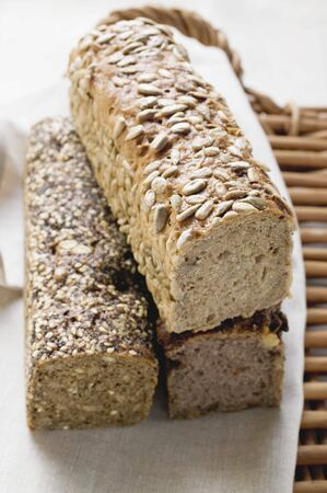 multi grain sandwich: Three wholemeal loaves on tea towel LANG_EVOIMAGES
