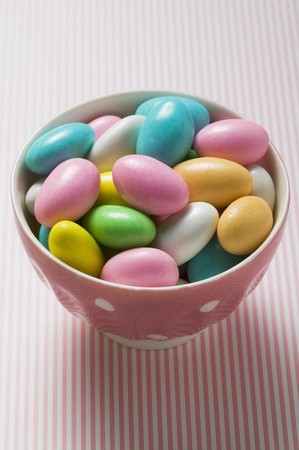 sugared almonds: Coloured sugared almonds in pink bowl