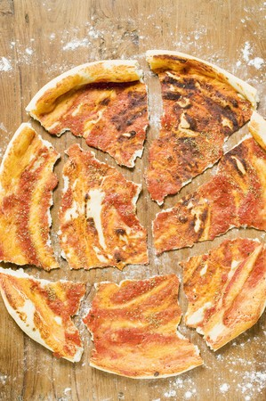 pizza base: Pizza base, roughly broken into pieces LANG_EVOIMAGES