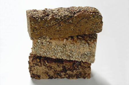 multi grain sandwich: Three wholemeal loaves, in a pile