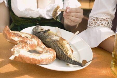 pretzel stick: Steckerlfisch (fish on stick) & pretzel (Oktoberfest, Munich) LANG_EVOIMAGES