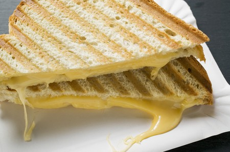 qs: Toasted cheese sandwiches on paper plate
