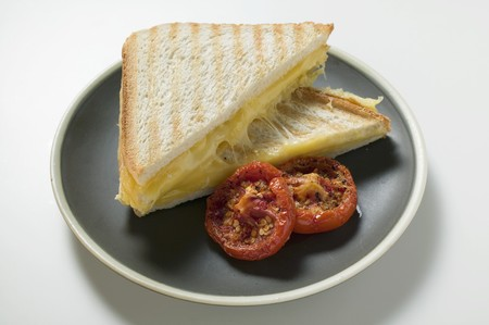 qs: Toasted cheese sandwiches and grilled tomatoes on plate
