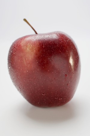 stark: Red apple, variety Stark, with drops of water