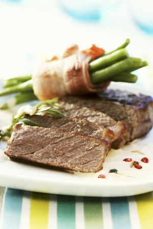 casings: Beef steak with green beans wrapped in bacon