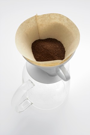 coffeepots: Ground coffee in filter on glass coffee pot