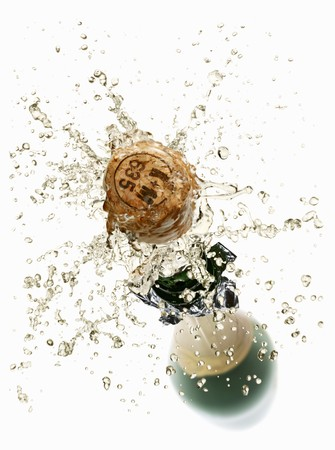 popping out: Cork flying out of a sparkling wine bottle
